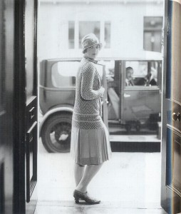 A cloche hat, jersey knit drop-waisted dress and low-heeled T-bar shoes were conventional day wear.