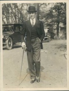 Alfie Dorchester, dapper young man on the ritz, would have carried a cane or umbrella and worn a bowler.
