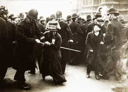 A woman struggles with the police on Black Friday, 18 November 1910.
