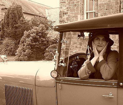 Fiona getting into character in a 1928 Ford Pheaton.